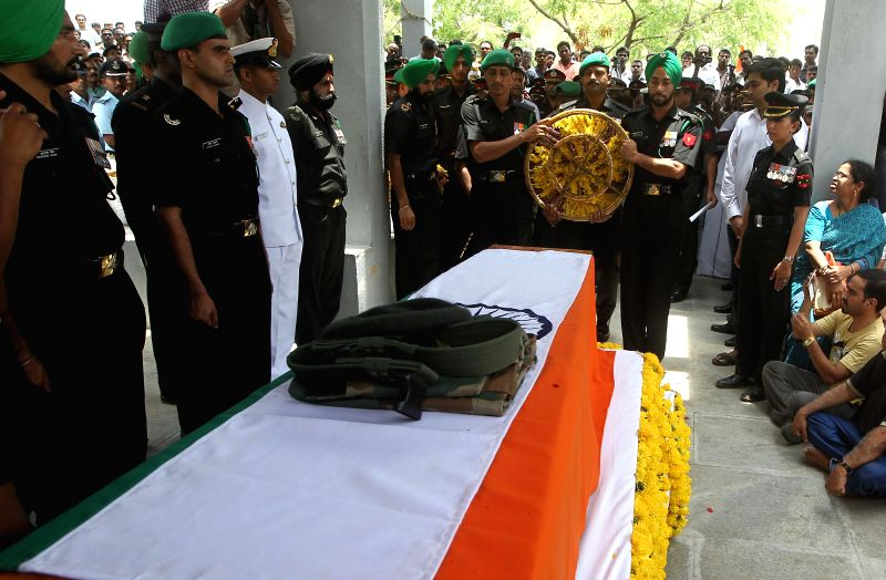 Soldiers pay tribute to Major Mukund Vardarajan who laid his life fighting militants during a joint operation of Army and Jammu and Kashmir police at Karewa Manloo in Shopian district of Jammu and ...