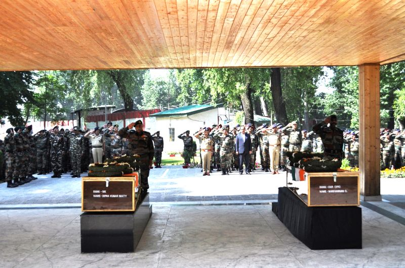 Soldiers pay tribute to two the two soldiers who had attained martyrdom in a dastardly terrorist action on an Army convoy in Qazigund; in Srinagar on June 4, 2017.