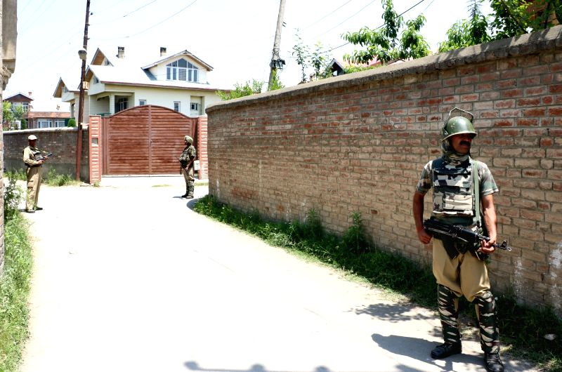 Soldiers posted outside one of the over 14 places in Srinagar that were raided by the NIA on June 3, 2017. The NIA has seized over Rs 1 crore during nearly two dozen raids conducted in ...