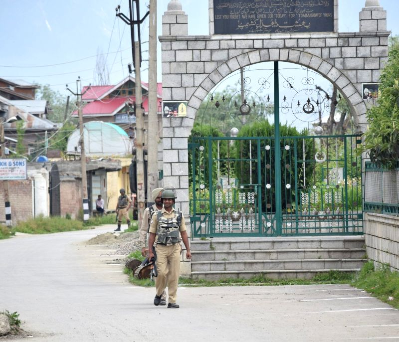 Soldiers stand guard as authorities imposed restrictions in old city areas of Srinagar to prevent a rally called by separatists. to commemorate the death anniversaries of two senior ...
