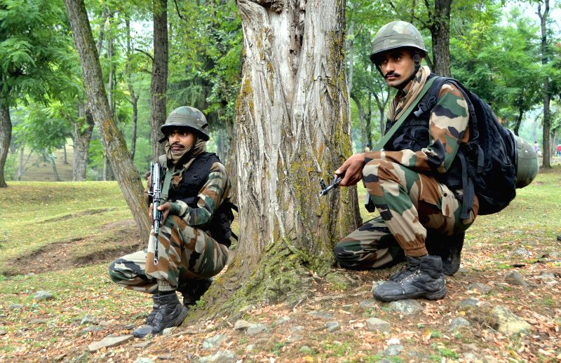 Soldiers take position during an encounter with the militants in Kupwara of Jammu and Kashmir on Aug 24, 2014.
