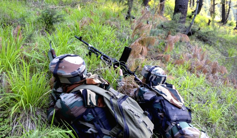 Soldiers take position during an encounter with militants in Jammu and Kashmir's Kupwara district on June 7, 2017. Three militants were killed during an ongoing operation near the Line of ...