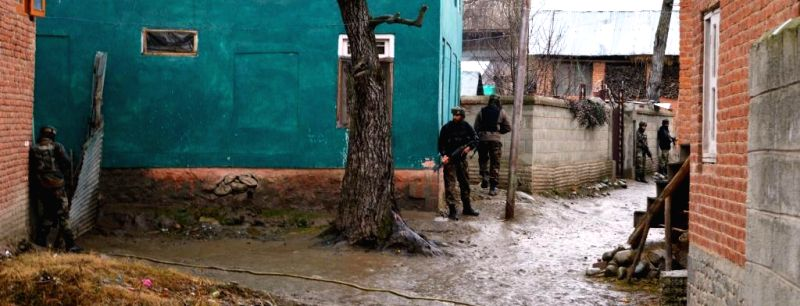 Soldiers take up their position during an encounter with guerrillas holed up in Jammu and Kashmir`s Shopian district on Feb 25, 2015. One guerrilla was killed in the gunfight.