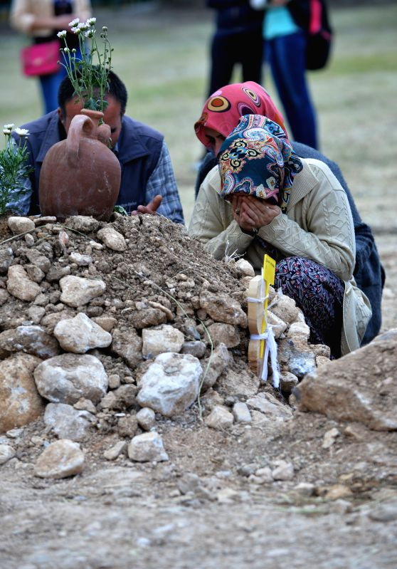 A woman cries beside a victim's grave in a cemetery in Soma of Manisa, Turkey, on May 15, 2014. The death toll in Turkey's worst coal mine disaster has risen to 292 ... - Taner Yildiz