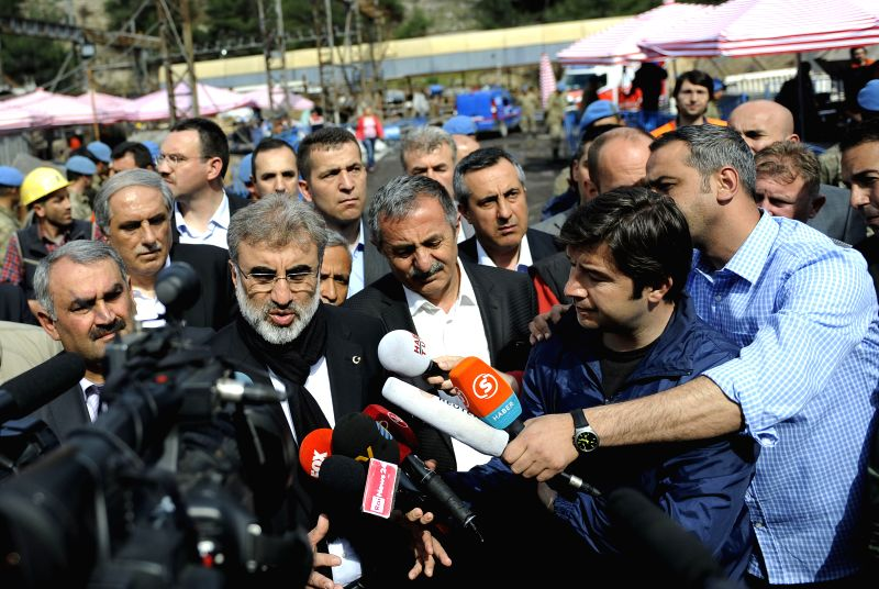 Turkish Energy Minister Taner Yildiz arrives to announce the final death toll in Soma of Manisa, Turkey, on May 17, 2014. Turkey stops rescue work on Saturday as death .