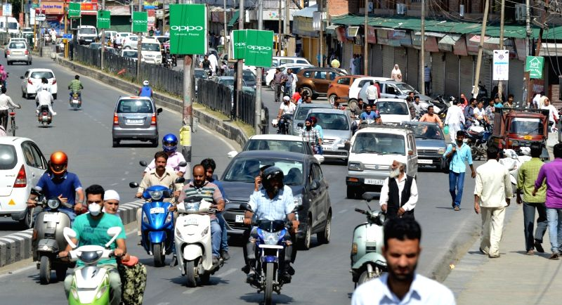 Some traffic moment in civil lines area of Srinagar after authorities relaxed curfew as normalcy gradually returns in the tension-gripped Kashmir valley on July 21, 2016.