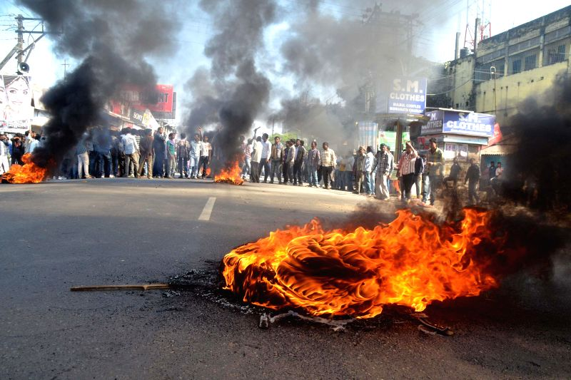 Activist of All Assam Tea Tribes Student Association burn tyres to block NH-52 at Biswanath Chariali  in Sonitpur district of Assam to protest against Tuesday's militant attacks in Assam's .