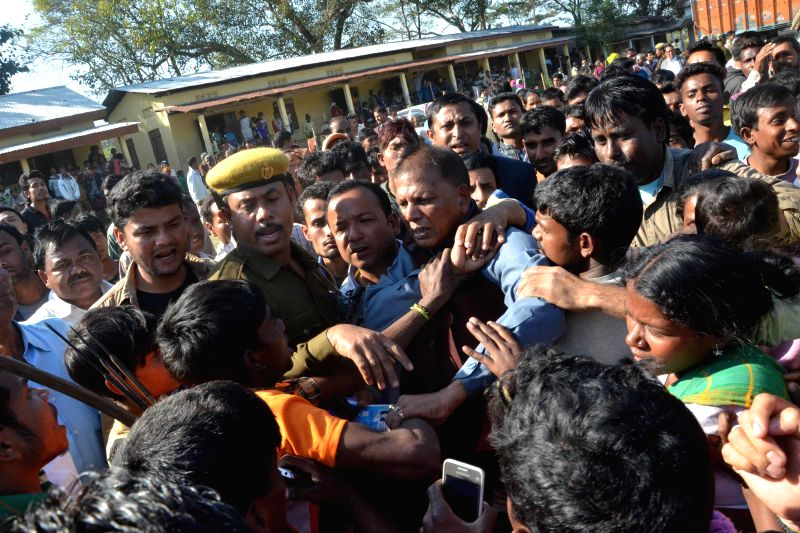 Rangapara legislator Bhimananda Tanti faces the wrath of displaced tribals during his visit to a relief camp at Tinikhuti village in Sonitpur of Assam on Dec 25, 2014.