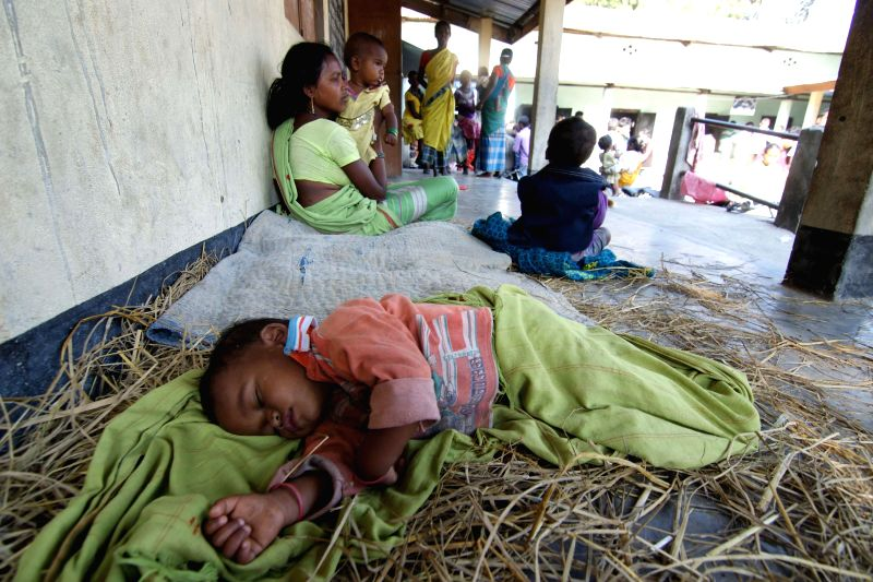 Villagers take refuge in a makeshift relief camps in the wake of the recent violence in Assam that left 73 dead in Samukjuli, Sonitpur of Assam, on Dec 27, 2014.