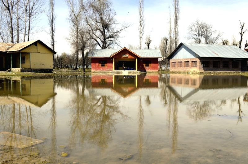 A view of waterlogged primary school in Lalad of Jammu and Kashmir's Sopore on March 23, 2015.