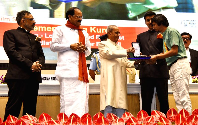 "Sound Recordist Chistopher Burchell, who won Best On Location Sound Recordist award  for ""Remembering Kurdi"", being felicitated by President Pranab Mukherjee at the 64th National ... - M. Venkaiah Naidu, Pranab Mukherjee and Rajyavardhan Singh Rathore"