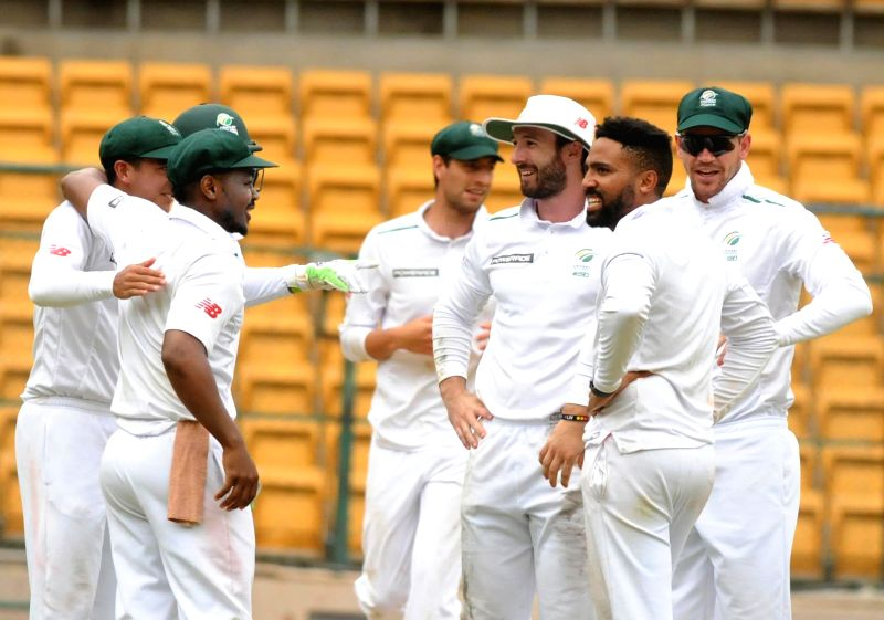 South Africa A cricketers celebrate fall of Prithvi Shaw's wicket during the 2nd day of four day test match between India A and South Africa A  at M Chinnaswamy Stadium, in Bengaluru on ...