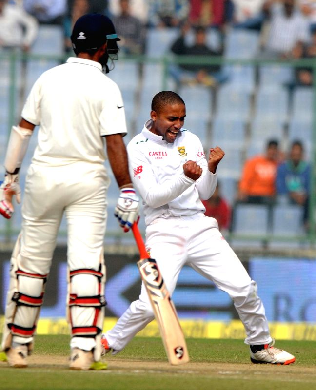 South African cricketer Dane Piedt celebrates Shikhar Dhawan's wicket during the Fourth and the final test match between India and South Africa at the Feroz Shah Kotla Stadium in New Delhi ...