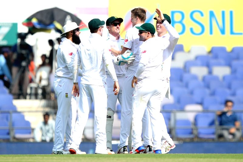 South African cricketers celebrate fall of a wicket during the Day-1 of the third test match between India and South Africa at Vidarbha Cricket Association Stadium in Nagpur  on Nov 25, 2015.