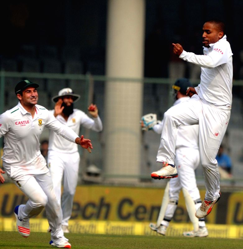 South African cricketers celebrate fall of a wicket during the Fourth and the final test match between India and South Africa at the Feroz Shah Kotla Stadium in New Delhi on Dec. 3, 2015.