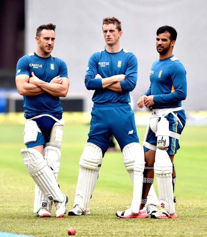 South African cricketers Faf du Plessis, JP Duminy and Dane Vilas during a practice session ahead of the 2nd test match against India at Chinnaswamy Stadium, in Bengaluru on Nov. 13, 2015.