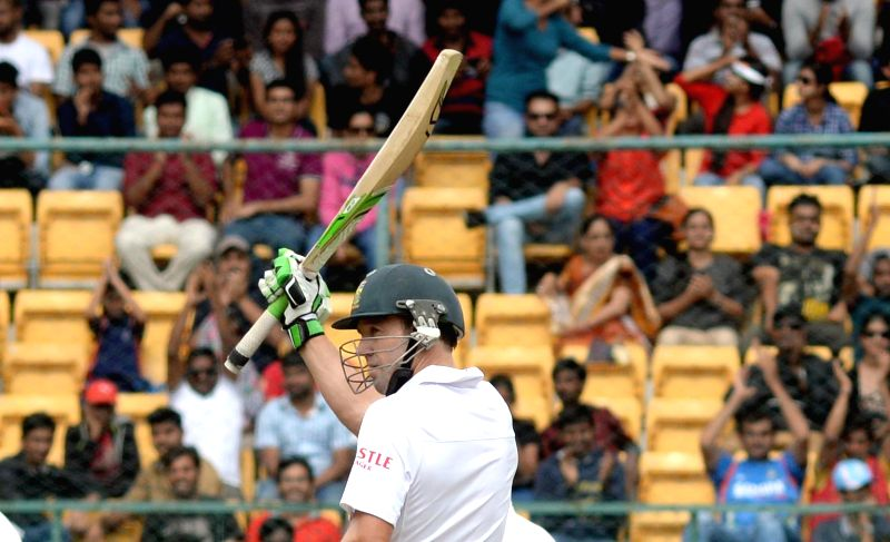 South African player AB de Villiers celebrates hius half century during the first day of the second test match between India and South Africa at M Chinnaswamy Stadium in Bengaluru, on Nov ...