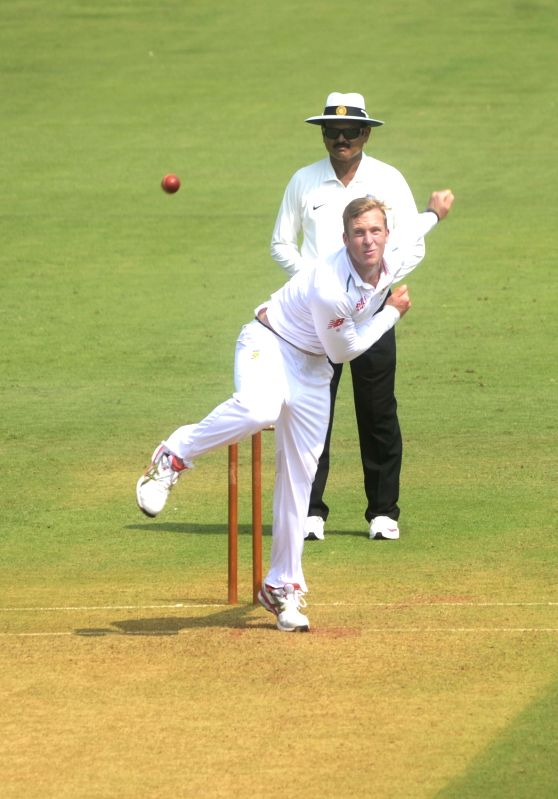 South African player Simon Harmer in action during a match between Indian Board President`s XI and South African at Brabourne Stadium in Mumbai on Oct 30, 2015.
