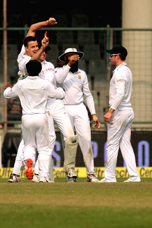 South African players celebrate fall of a wicket during the third day of the Fourth and the final test match between India and South Africa at the Feroz Shah Kotla Stadium in New Delhi on ...
