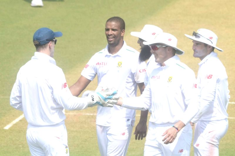 South African players celebrate the fall of a wicket during a match between Indian Board President`s XI and South African at Brabourne Stadium in Mumbai on Oct 30, 2015.