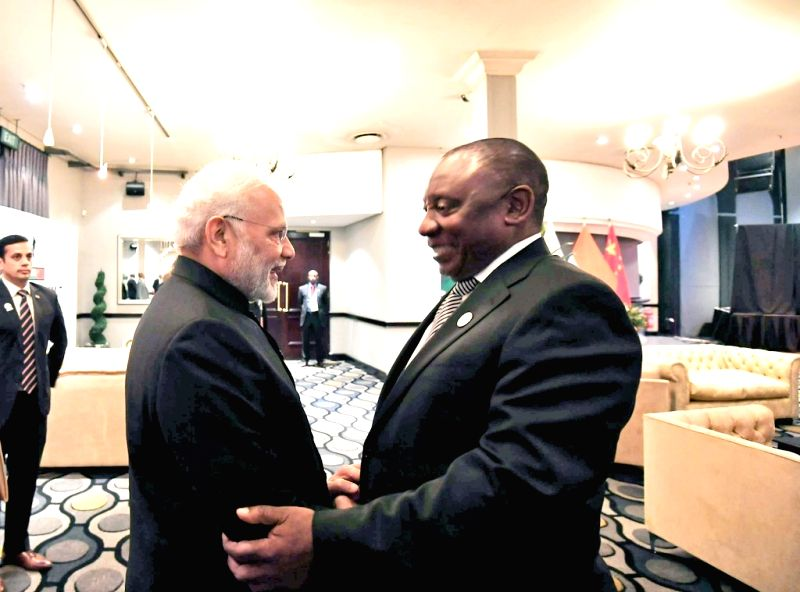 South African President Cyril Ramaphosa welcomes Prime Minister Narendra Modi on his arrival in Johannesburg, South Africa on July 25, 2018. - Narendra Modi