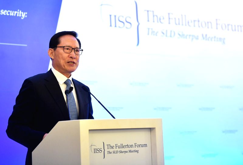 South Defense Minister Song Young-moo delivers a keynote speech at the Fullerton Forum, a multilateral security forum, in Singapore on Jan. 29, 2018, in this photo provided by the defense ... - Song Young