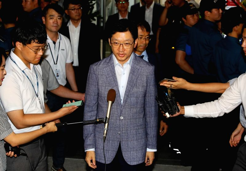 South Gyeongsang Province Gov. Kim Kyoung-soo leaves the special counsel's office in Seoul on Aug. 7, 2018, after undergoing questioning overnight over his alleged involvement in a massive ...