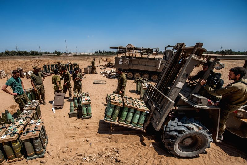 An Israeli forklift leaves after collecting shells for self-propelled howitzers in southern Israel bordering the Gaza Strip, on Aug. 6, 2014. Israel has agreed .