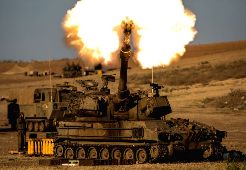 An Israeli self-propelled howitzer fires a shell to the Gaza Strip in south Israel bordering the Gaza Strip on July 21, 2014, the 14th day of Israel's ...