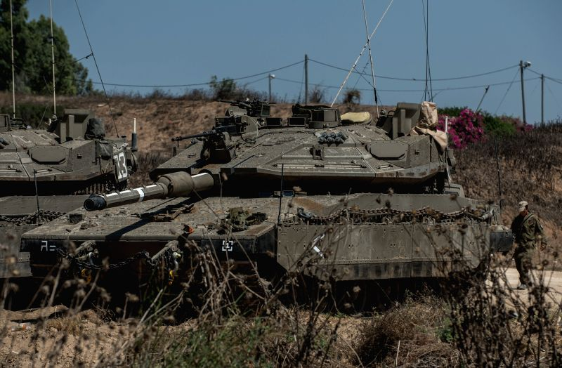 Israeli tanks are deployed in south Israel bordering the Gaza Strip on July 8, 2014. Israel's security cabinet decided on Tuesday to draft 40,000 reserve ...