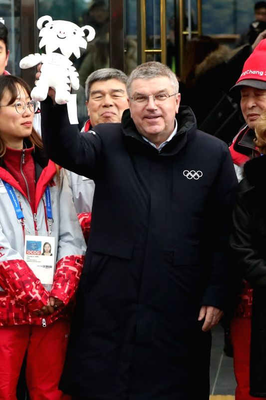 South Korea: International Olympic Committee (IOC) President Thomas Bach (C) holds up the mascot of the 2018 PyeongChang Winter Olympics, the white tiger Soohorang, at Jinbu Station in the alpine ...