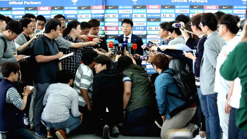 South Korea men's national football team coach Shin Tae-yong holds a press conference at Incheon International Airport, west of Seoul, on June 3, 2018 before heading out with his team to ...