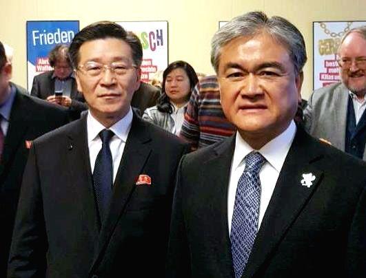 South Korean ambassador to Germany Jong Bum-goo (R) meets with North Korean ambassador Pak Nam-yong at an event in Berlin on Jan. 31, 2018.