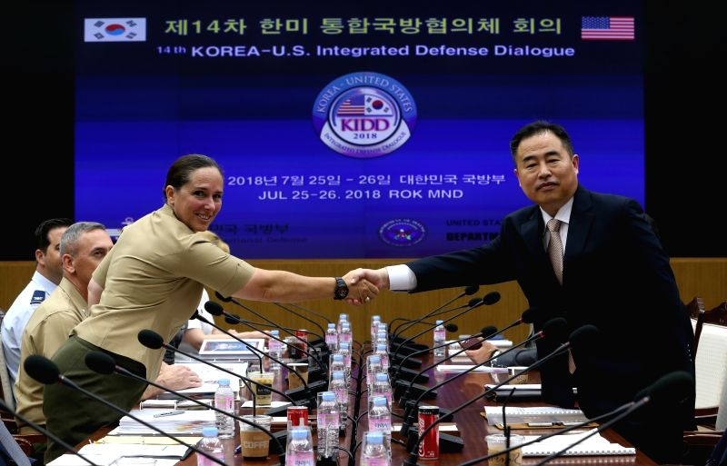South Korean Deputy Minister for National Defense Policy Yeo Suk-joo (R) poses for a photo with Roberta Shea, U.S. acting deputy assistant secretary of defense, at the defense ministry in ...
