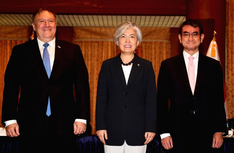 South Korean Foreign Minister Kang Kyung-hwa (C) poses with U.S. Secretary of State Mike Pompeo (L) and Japanese Foreign Minister Taro Kono ahead of their meeting at the foreign ministry ... - Kang Kyung