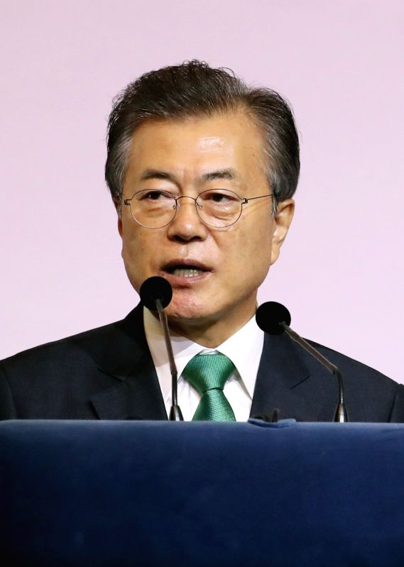 South Korean President Moon Jae-in delivers a special lecture at a Singapore hotel on July 13, 2018, calling for sincere efforts on all sides to move the North Korean denuclearization ...