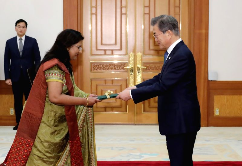 South Korean President Moon Jae-in (R) receives credentials from new Bangladeshi Ambassador to Seoul Abida Islam at the presidential office Cheong Wa Dae on Jan. 31, 2018.