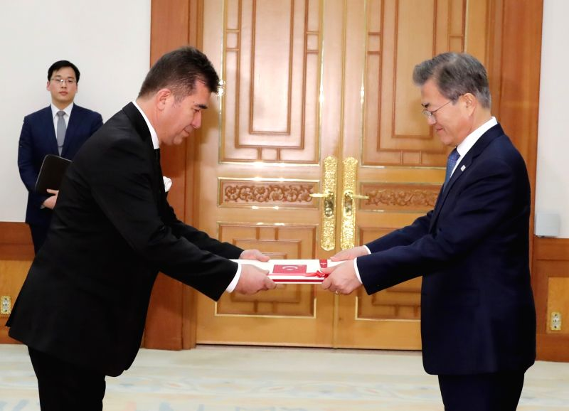 South Korean President Moon Jae-in (R) receives credentials from new Turkish Ambassador to Seoul Ersin Ercin at the presidential office Cheong Wa Dae on Jan. 31, 2018.