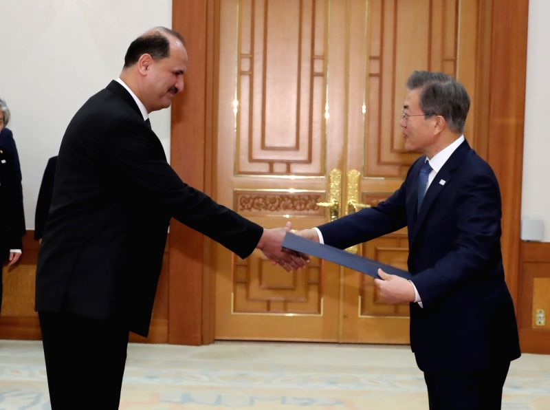 South Korean President Moon Jae-in (R) shakes hands with new Egyptian Ambassador to Seoul Hazem Fahmy after receiving credentials from him at the presidential office Cheong Wa Dae on Jan. 31, ...