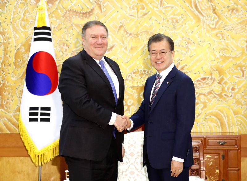 South Korean President Moon Jae-in (R) shakes hands with U.S. Secretary of State Mike Pompeo during their meeting at the presidential office in Seoul on June 14, 2018.