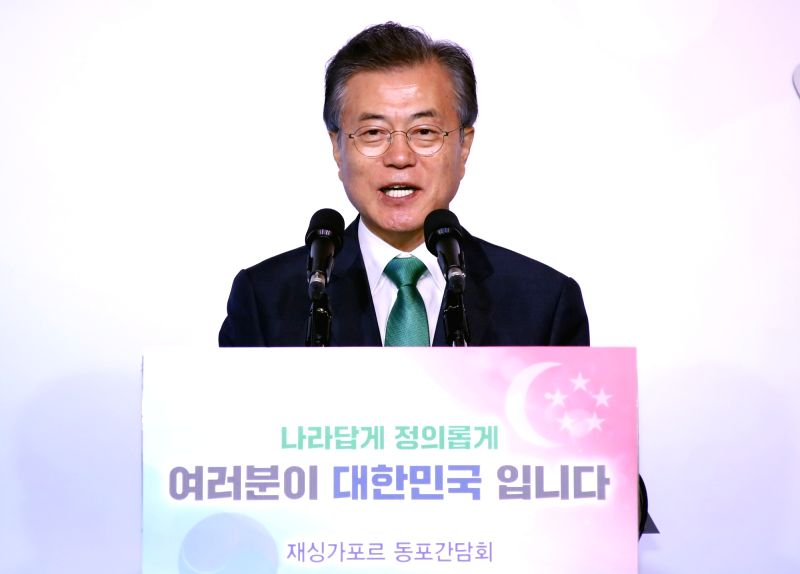 South Korean President Moon Jae-in speaks during a meeting with Korean residents at a Singapore hotel on July 13, 2018. Moon is on a three-day visit to the city state.