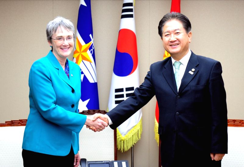 South Korean Vice Defense Minister Suh Choo-suk (R) shakes hands with U.S. Air Force Secretary Heather Wilson during their meeting at the Defense Ministry in Seoul on Jan. 30, 2018, in this ... - Suh Choo
