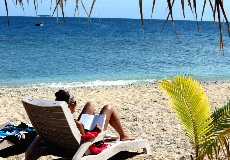 A tourist takes a rest on the South Sea island of Fiji, June 21, 2014. Fuji is an island country in the South Pacific Ocean with more than 332 islands, ...