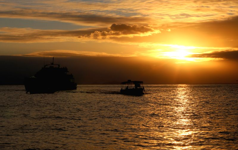 Ships leave the South Sea island of Fiji, June 21, 2014. Fuji is an island country in the South Pacific Ocean with more than 332 islands, including two ...
