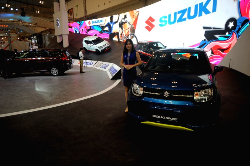 SOUTH TANGERANG, Aug. 2, 2018 - A model stands by a vehicle displayed during the GAIKINDO Indonesia International Auto Show (GIIAS) 2018 held in South Tangerang, Indonesia, on Aug. 2, 2018.