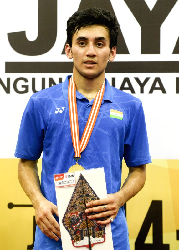 SOUTH TANGERANG, July 22, 2018 - Lakshya Sen of India poses for photos during the awarding ceremony after men's single final match against Kunlavut Vitidsarn of Thailand at the Badminton Asia Junior ...
