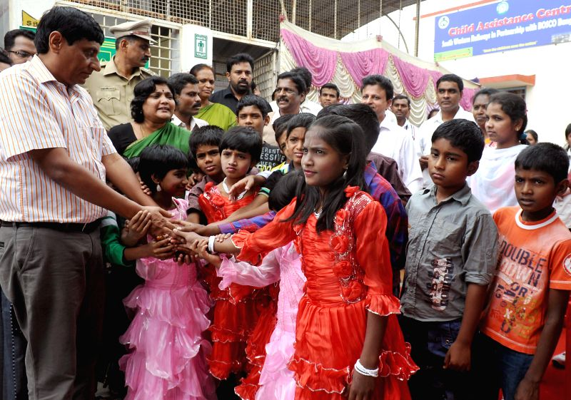 South Western Railways Division Railway Manager Anil Kumar Agarwal interacts with children during inauguration of Child Assistance Centre at Bangalore City railway station on July 9, 2014.