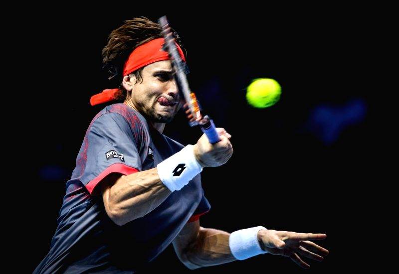 Spain's David Ferrer hits a return during the group stage match against Spain's Rafael Nadal at the ATP World Tour Finals in London, Britain, Nov. 20, 2015. Nadal ...
