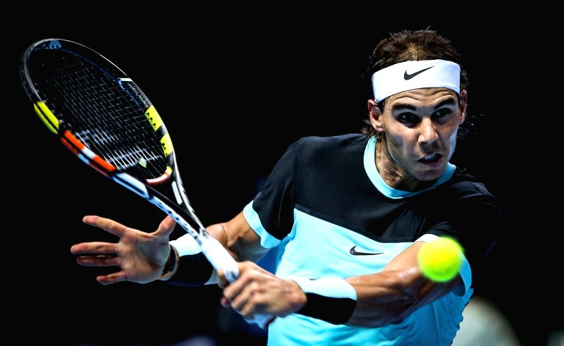Spain's Rafael Nadal hits a return during the group stage match against Spain's David Ferrer at the ATP World Tour Finals in London, Britain, Nov. 20, 2015. Nadal ...