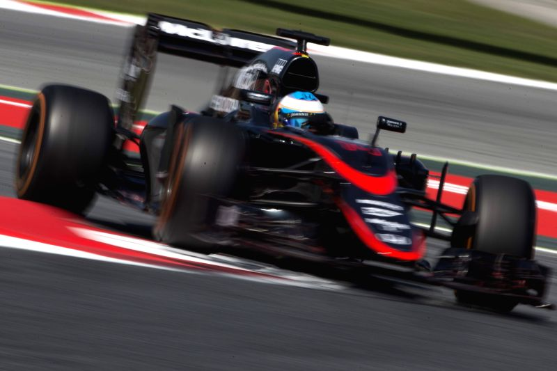 Spanish F-1 driver Fernando Alonso, of McLaren team, takes part in the first free training session at Circuit de Barcelona-Catalunya track, in Montmelo, outside Barcelona, northeastern Spain, ...